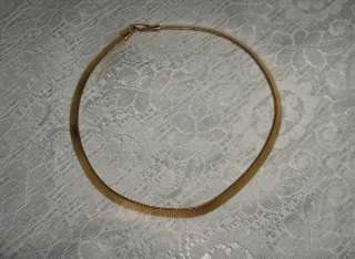 """Up for sale is a beautiful vintage gold tone ¼"""" wide band necklace"""