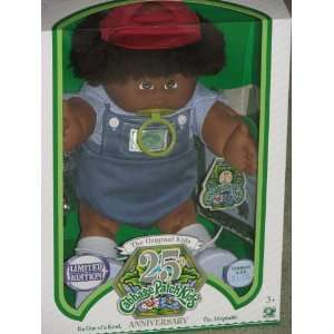 African American Boy Doll with Dark Brown Hair, Red Cap and Pacifier