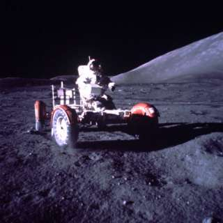 Unident. Apollo Xvii Astronaut Operating Lunar Surface Vehicle During