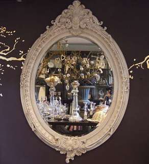 large ornate oval gold mirror by figa & co. ltd