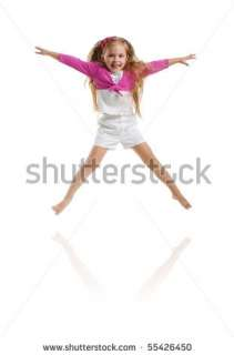 Cute Little Girl Jump. Studio Shot. White Background Stock Photo
